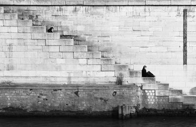 sales negotiations - figure sitting on white stairs
