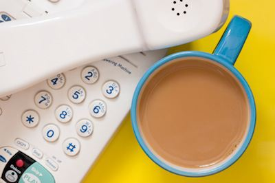 sales voicemail tips - phone and coffee