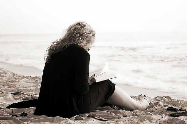 boost your confidence - woman reading on the beach